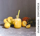 fresh yellow smoothie with... | Shutterstock . vector #1064140616