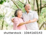 happy senior asian couple... | Shutterstock . vector #1064160143