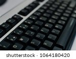 pc computer keyboard close up... | Shutterstock . vector #1064180420