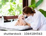little child taking bubble bath ...   Shutterstock . vector #1064184563