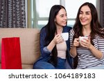 rest at home with friend. two... | Shutterstock . vector #1064189183