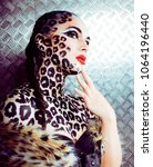 young sexy woman with leopard... | Shutterstock . vector #1064196440