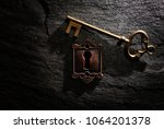 vintage lock with gold key on... | Shutterstock . vector #1064201378
