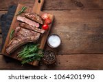grilled cowboy beef steak ... | Shutterstock . vector #1064201990