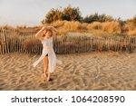beautiful kid girl dancing on... | Shutterstock . vector #1064208590