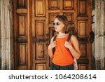 funny little girl traveler... | Shutterstock . vector #1064208614