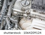 wash the engine with foam. the... | Shutterstock . vector #1064209124