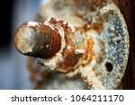 Old Rusty Bolt In Weathered...