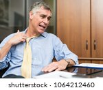 businessman sweating in his... | Shutterstock . vector #1064212460