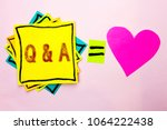 Small photo of Text sign showing Q A. Conceptual photo Ask Frequently Faq Asked Question Help Solving Doubt Query Support written on Stacked Sticky Note Papers on the plain background with Heart next to it.