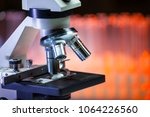 close up of microscope lenses. | Shutterstock . vector #1064226560