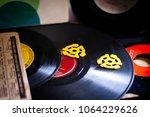 vinyl records and adaptors | Shutterstock . vector #1064229626