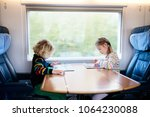 child traveling by train....   Shutterstock . vector #1064230088