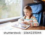 child traveling by train.... | Shutterstock . vector #1064235044