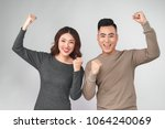 smiling happy asian couple... | Shutterstock . vector #1064240069