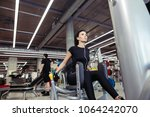 Small photo of Girl playing adductor, abductor leg in gym