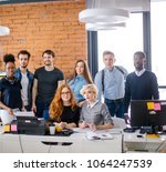 young ambitious workers with... | Shutterstock . vector #1064247539