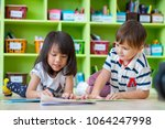 two kid lay down on floor and...   Shutterstock . vector #1064247998