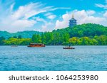 hangzhou west lake pagoda... | Shutterstock . vector #1064253980