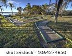 abandoned mini golf gourse. | Shutterstock . vector #1064274650