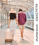 young couples with luggage ... | Shutterstock . vector #1064279759