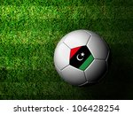 Libya Flag Pattern 3d rendering of a soccer ball in green grass - stock photo