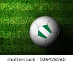 Nigeria Flag Pattern 3d rendering of a soccer ball in green grass - stock photo