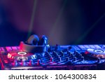 Small photo of In selective focus of Pro DJ controller.The DJ console CD mp4 deejay mixing desk Ibiza house music party in nightclub with colored disco lights.