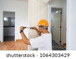 scene of locksmith repair knob... | Shutterstock . vector #1064303429