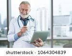 portrait of senior doctor... | Shutterstock . vector #1064304839
