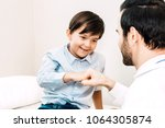 doctor giving fist bump with... | Shutterstock . vector #1064305874