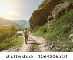 young man in mountains | Shutterstock . vector #1064306510