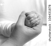 mother hand holding newborn... | Shutterstock . vector #106431878