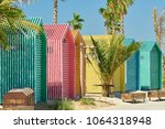 colored beach bathing cabins in ... | Shutterstock . vector #1064318948