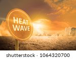 heat wave sign on the city.... | Shutterstock . vector #1064320700