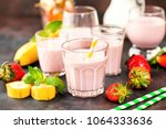 strawberry and banana smoothie... | Shutterstock . vector #1064333636