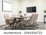 small meeting room with leather ... | Shutterstock . vector #1064336723