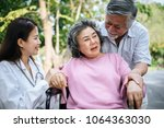nurse looking at elderly...   Shutterstock . vector #1064363030
