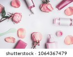 Stock photo flat lay frame of flowers and cosmetics products with rose essential oil toner serum essence 1064367479