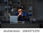 businessman working late at... | Shutterstock . vector #1064371253