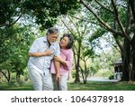 old man having a chest pain | Shutterstock . vector #1064378918