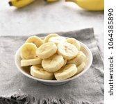 banana slices in bowl. healthy... | Shutterstock . vector #1064385890