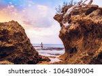 beach sunset at the neil... | Shutterstock . vector #1064389004