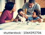 family saving money to piggy... | Shutterstock . vector #1064392706