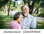 happy senior couple in the park | Shutterstock . vector #1064395064