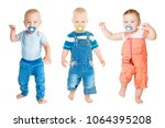 Small photo of Baby Sucking Pacifier, Infant Kids Group Suck Soother Dummy and Dancing, Children Isolated on White Background, one year old