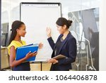 two interracial business women... | Shutterstock . vector #1064406878