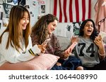 teenage girls using smartphones ... | Shutterstock . vector #1064408990