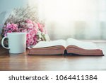 holy bible with a cup of coffee ... | Shutterstock . vector #1064411384