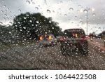 blured background with rains... | Shutterstock . vector #1064422508